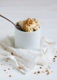 Milk and nutdessert. Milk and nut dessert in a gravy boat Royalty Free Stock Photos