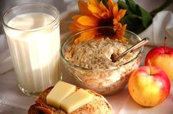 Milk oatmeal. Breakfast with milk oatmeal apples bread cheese Stock Photo