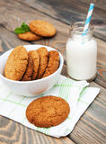 Milk and oatmeal cookies Royalty Free Stock Photo