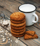 Milk and oatmeal cookies Royalty Free Stock Images