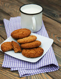 Milk and oatmeal cookies Stock Photography