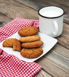 Milk and oatmeal cookies Royalty Free Stock Image