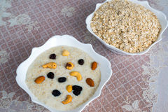 Milk oatmeal with nuts and raisins Royalty Free Stock Photography