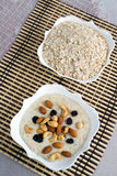 Milk oatmeal with nuts and raisins Stock Images