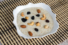 Milk oatmeal with nuts and raisins Stock Image