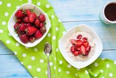 Milk oatmeal porridge with strawberries Stock Image