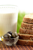 Milk and olive with bread Stock Images