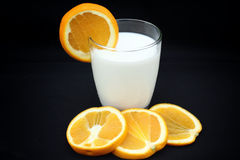 Milk with orange fruit Stock Photos