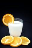 Milk with orange fruit Royalty Free Stock Images