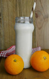 Milk and orange fruits Stock Images