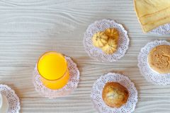Milk Orange Juice Cookie Banana Cupcake Cupcake and Butter Bread on White Wooden Table stock images