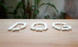 Milk pellets in bone shape in Dog wording Stock Image