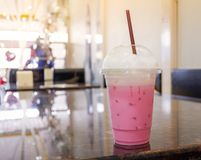 Milk pink. In plastic cup In the cafe Shop royalty free stock photo