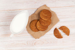 Milk pitcher and gingerbread cookies Royalty Free Stock Photography