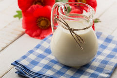 Milk in pitcher  on wooden table Stock Images