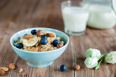 Milk porridge breakfast with nuts and berries Royalty Free Stock Photography