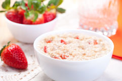 Milk porridge with fresh strawberries Stock Images