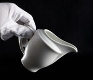 Milk pot's hand Royalty Free Stock Images