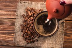 Milk pour into a coffee cup Royalty Free Stock Photo
