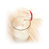 Milk poured from bottle Stock Image