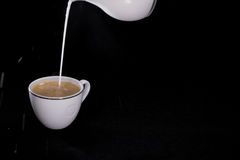 Milk poured in a Cup of coffee Royalty Free Stock Photography
