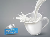 Milk pouring into a cup Stock Image