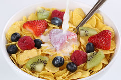 Milk pouring into fruit muesli Royalty Free Stock Image