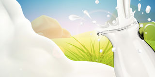 Milk pouring in transparent glass jug on bright background Stock Photography