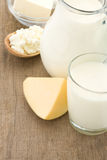 Milk products and cheese on wood Royalty Free Stock Images
