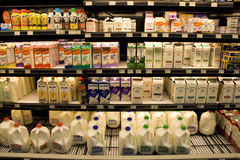 Milk products on store shelves Stock Photos