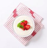 Milk pudding with strawberries Stock Images