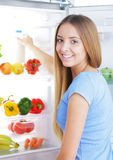 Milk in the refrigerator royalty free stock photography