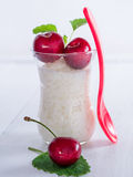 Milk rice with cherries Stock Images