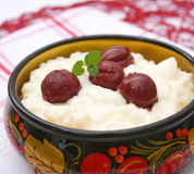 Milk rice with cherries. Some fresh milk rice with cherries Stock Image