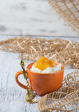 Milk rice porridge with orange jam Stock Photos