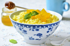 Milk rice porridge with pumpkin and honey. Stock Image