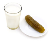 Milk and salted cucumber. Stock Images