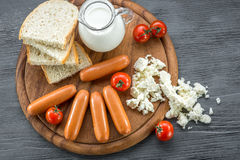 Milk sausages on wooden desk Stock Photography