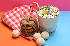 Milk shake with coconut candies and cookies Stock Photos