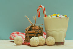 Milk shake with coconut candies and cookies Royalty Free Stock Photography