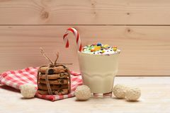 Milk shake with coconut candies and cookies Royalty Free Stock Photos