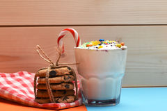 Milk shake with colorful candies and cookies Stock Photos