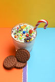 Milk shake with colorful candies and cookies Stock Photo