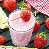 Milk shake with fresh strawberries Stock Photography