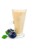 Milkshake with two black plums Royalty Free Stock Images