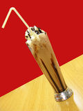 Milk shake and ice cream. At restaurant, in glass vase royalty free stock photography