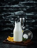 Milk-shake. Ice cream, milk and fruit. On a wooden background. Top view stock image