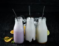 Milk-shake. Ice cream, milk and fruit. On a wooden background. Top view stock photos
