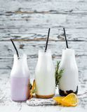 Milk-shake. Ice cream, milk and fruit. On a wooden background. Top view stock photography