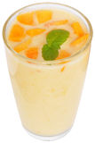 Milk shake from peach yogurt. On a white background Royalty Free Stock Image
